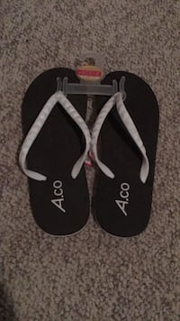 Brand new with tags. Size 5-6 flip flops