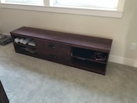 brown wooden 2-drawer TV stand null