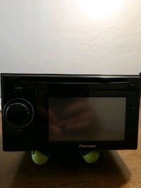 black Pioneer 1-DIN car stereo head unit