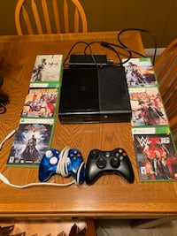 black Xbox 360 console with controller and game cases Riverside, 92503