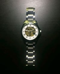 round silver-colored chronograph watch with link b Milton, L9T 3P6