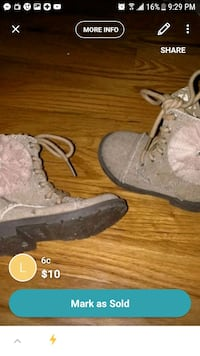pair of gray suede fringe boots Brooklyn, 11207