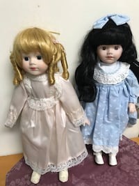 Two porcelain dolls 16 inch tall