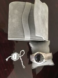 Silver and gold analog watch. Very rare find
