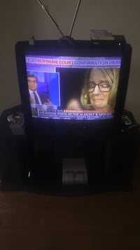 black flat screen TV with remote Shreveport