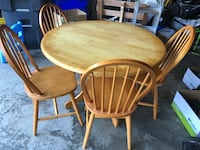 """Wooden round table (42"""" wide) with 4 chairs"""