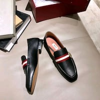 black-and-red leather loafers