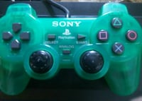 green and black Sony PS4 controller