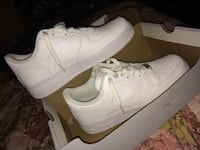 pair of white Nike air force 1 low 1201 mi