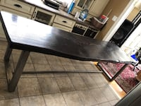 """Long live edge red oak table with lacquered raw steel legs 9'2"""" long x 29"""" wide x 3"""" thick, very heavy."""