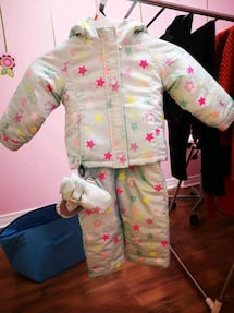Children place winter jacket, snow pants and ????