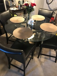 round black wooden table with four chairs dining set Rockville, 20852