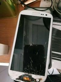 white Samsung Galaxy android smartphone for parts