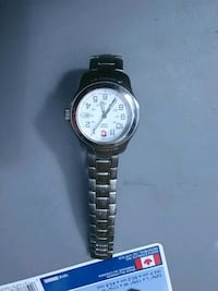 round silver-colored chronograph watch with link bracelet Toronto, M5A 4H4