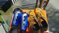 pair of green Nike cleats with pair of blue Nike shin guards Colton, 92324