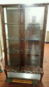 brown wooden framed glass display cabinet negotiab