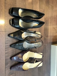three pairs of black leather pointed-toe pumps Calgary, T3E 5S9