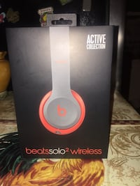 Gray and red beats by dre wireless headphones