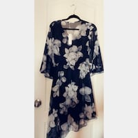 Black long sleeve assymetrical dress with flower print. tags attrached Mississauga, L5C 1E1