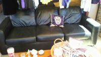Leather couch,chair,2 lamps. Ashley furniture