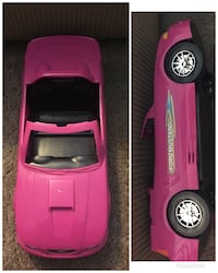 two pink and black car toys Akron, 44305