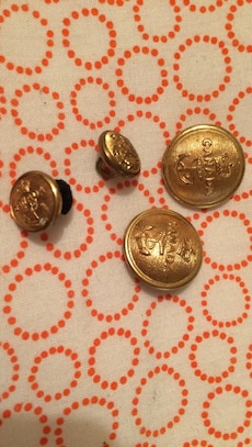 Brass navy buttons from world war 2. Worth $16 per button on eBay selling each for 10 bucks or 3 for 20.