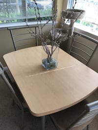 round white wooden table with four chairs dining set San Diego, 92108