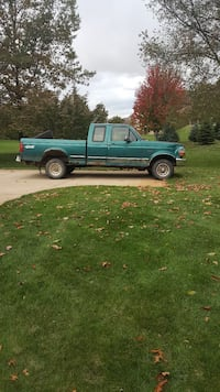 blue extra cab pickup truck