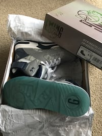 pair of gray Nike Air Force 1 low