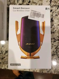 Car Wireless Charger. Brand new in box. Ordered 1 got 2