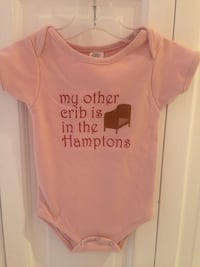 Baby onesie with exclusive logo