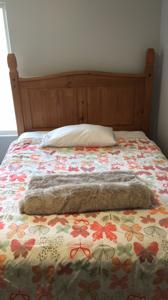 used brown wooden bed frame and white and red floral bedspread for rh us letgo com