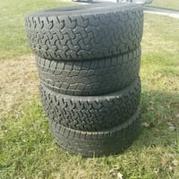 four black vehicle wheels with tires Woodlawn, 21207