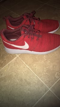 pair of red Nike running shoes Gloversville, 12078