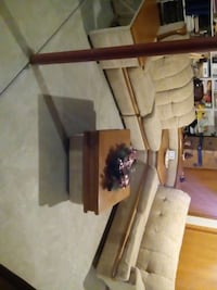 brown wooden framed white padded couch