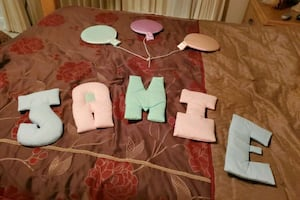 Letters for the name JAMIE or JAIME and the balloons for the wall