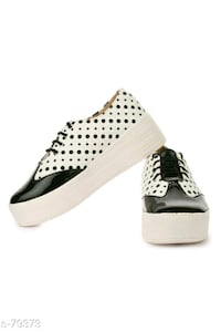 pair of black-and-white leather polka dot platform sneakers Noida, 201301
