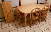 round brown wooden table with four chairs dining set Boston, 02114