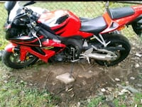 red and black sports bike Clinton
