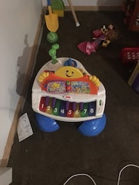 baby's white and blue activity table