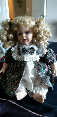 Beautiful Porcelain Doll  ( Airdrie)
