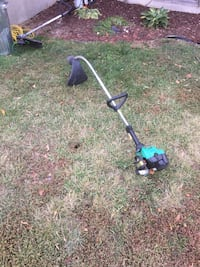 black and green string trimmer , T0J