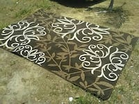 white, beige and black foliage area rug