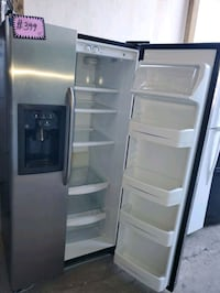 GE side by side doors fridge working perfectly  Baltimore, 21223