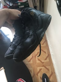 pair of black leather boots New York, 10034