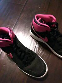 pair of black-and-pink Nike running shoes 2224 mi