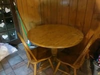 round brown wooden table with four chairs dining s Fairfax, 22030