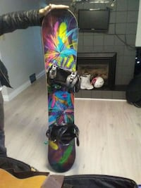 black and green snowboard with bindings Kelowna, V1X 2L4