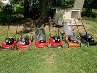 four red and black push mowers Gainesville