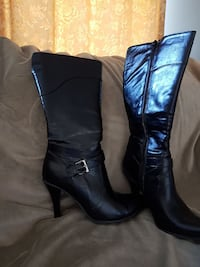 pair of black leather buckled heeled boots